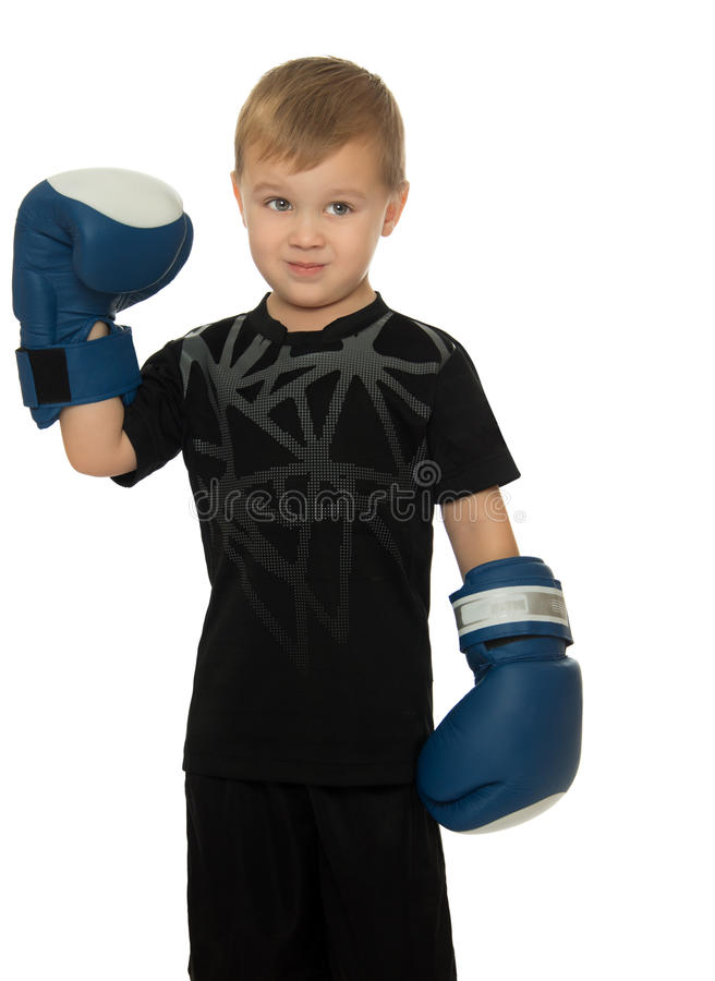 Boy with Boxing gloves. Little boy engaged in Boxing. In his hands he's got the Boxing gloves. Close-up- Isolated on white background stock photography