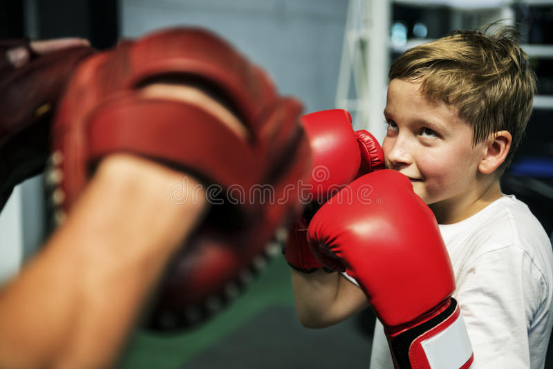 Boy Boxing Training Punch Mitts Exercise Concept royalty free stock images