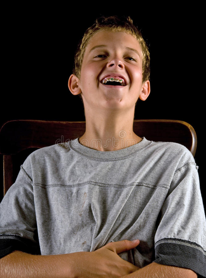 Boy with braces, laughing royalty free stock image