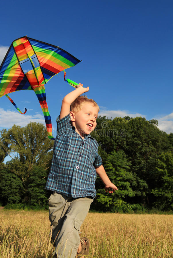 Download Boy With Bright Kite Over The Head Royalty Free Stock Photography - Image: 25521967
