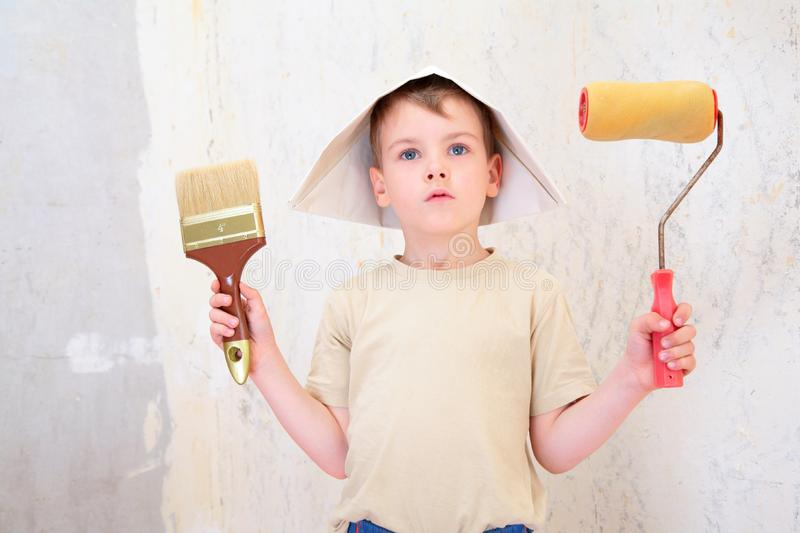 Boy with brush and roller in paper hat stock photos
