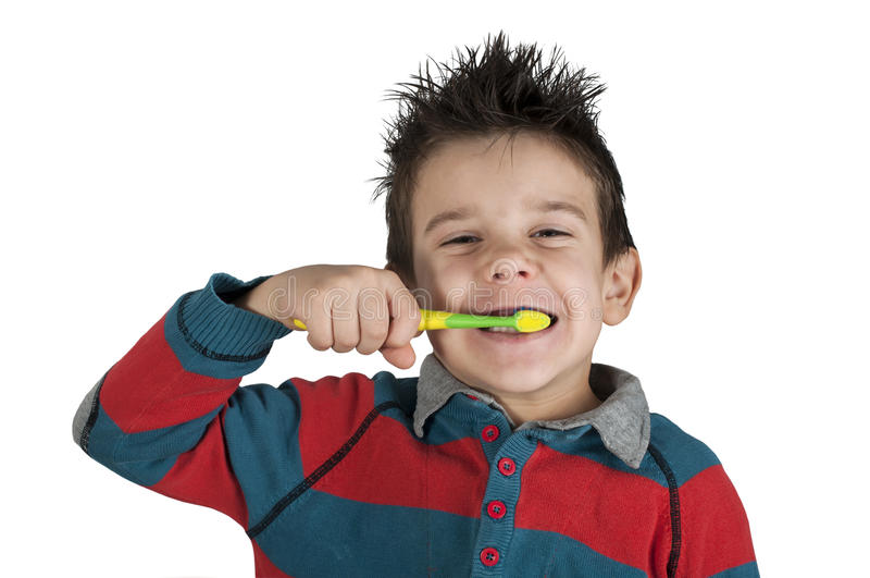 Boy brushing his teeth royalty free stock images