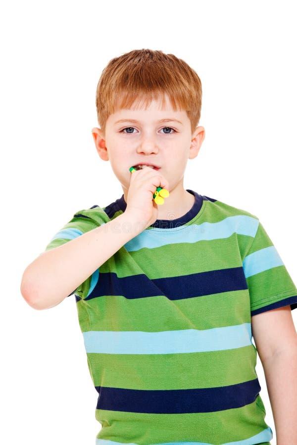 Boy brushing teeth royalty free stock images