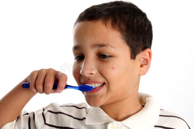 Boy Brushing Teeth stock photo