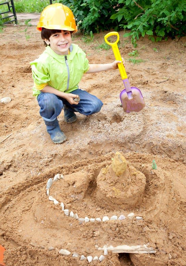 Boy builder in a protective helmet stock photo