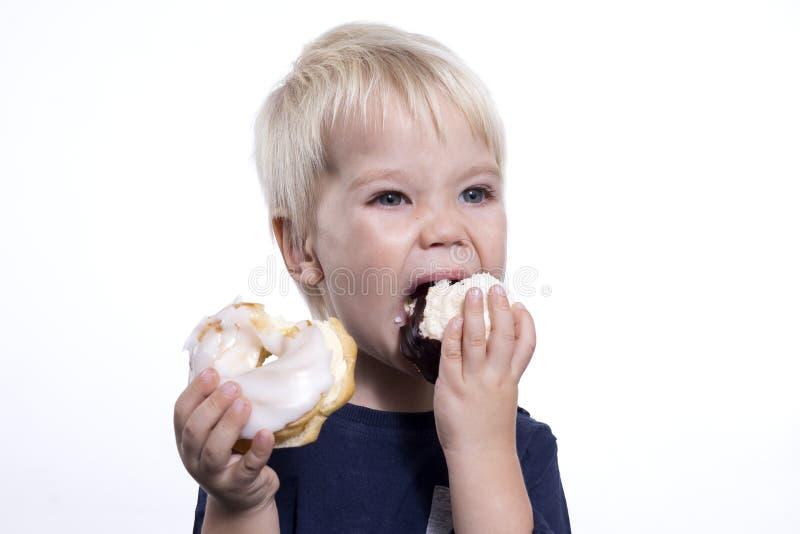 Boy with cakes stock photos