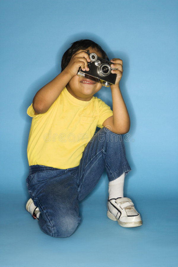 Boy with camera. royalty free stock image