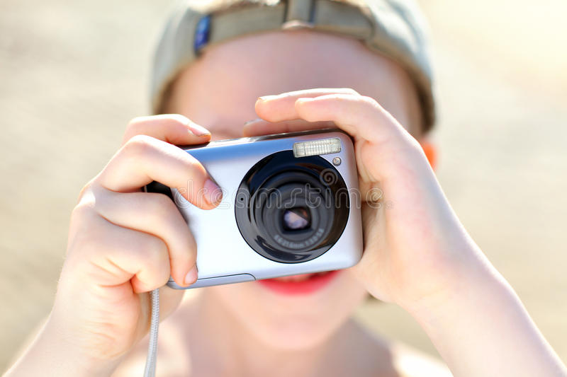 Boy with camera. Small boy with photocamera outdoor stock photography