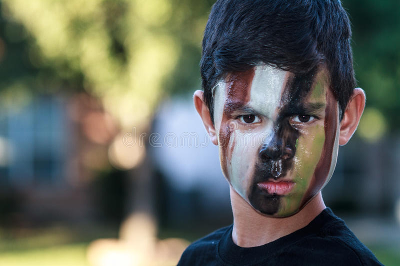 Boy in camouflage royalty free stock photography