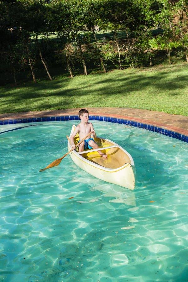 Boy Canoe Pool Stock Image. Image Of Water, Playing, Image