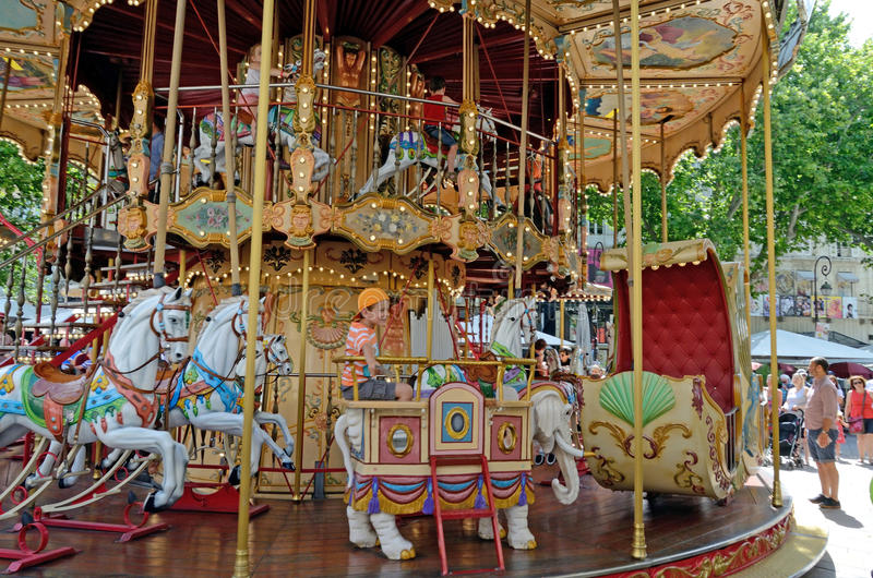 Boy on a Carousel, Avignon, France stock photo