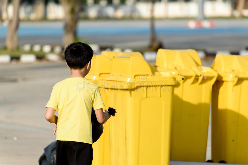 Boy carry garbage in bag for eliminate to the bin royalty free stock photo