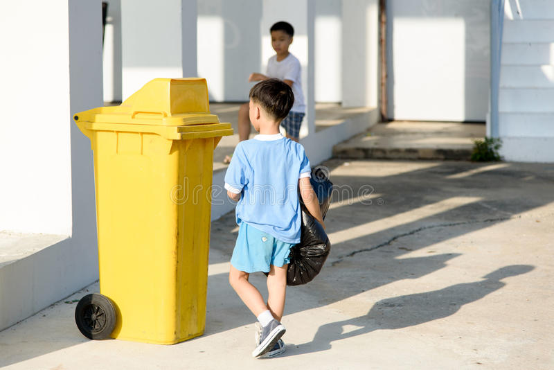 Boy carry garbage royalty free stock photography
