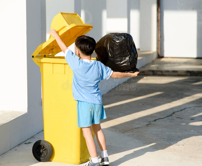Boy carry garbage stock images