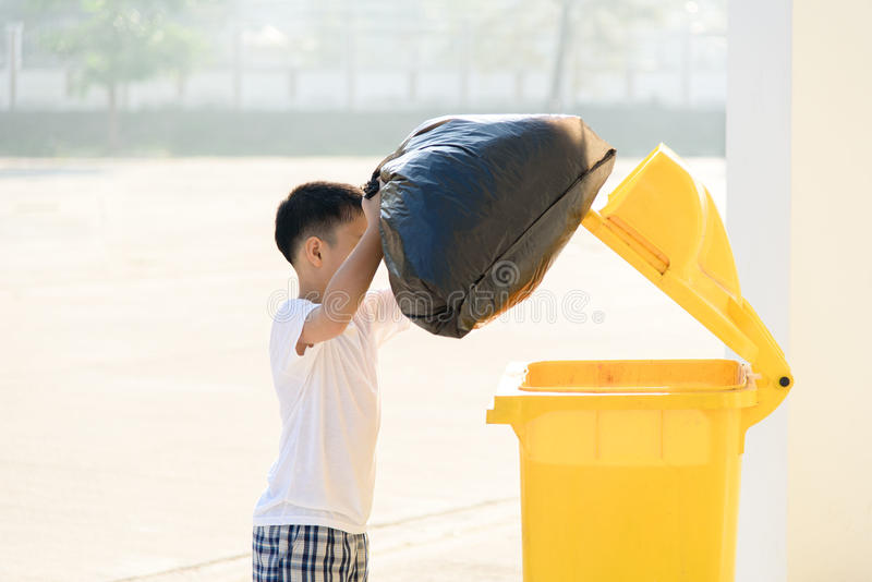 Boy carry garbage royalty free stock photo