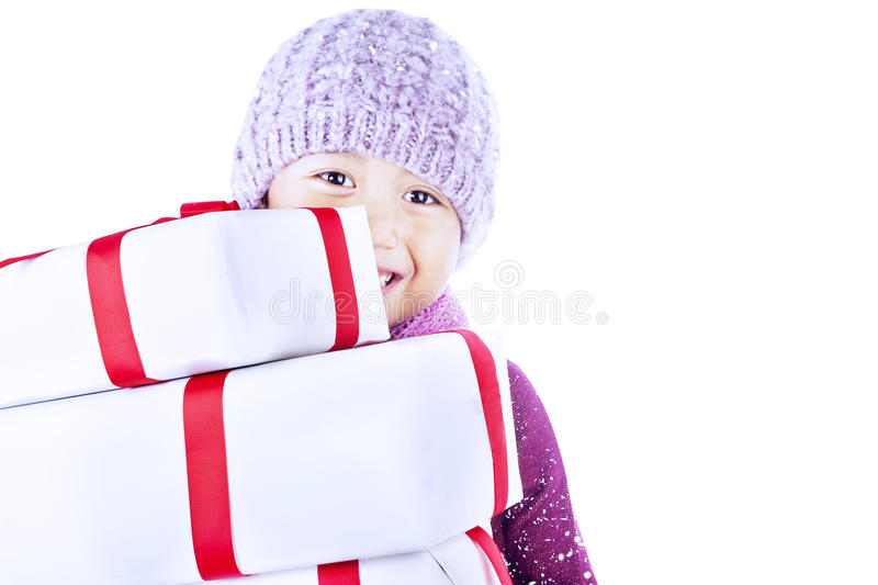 Boy carry holiday gifts-isolated in white stock photo