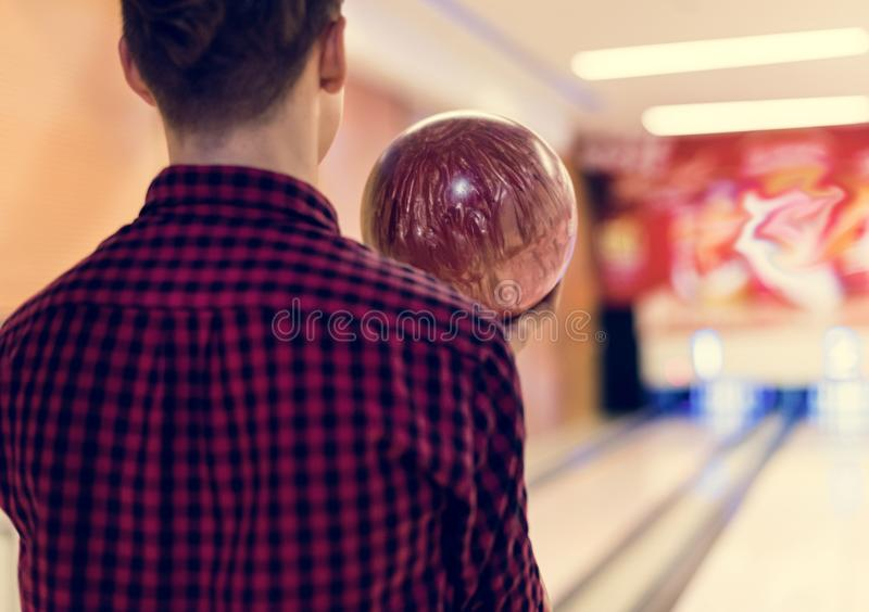 Boy carrying the bowling ball stock photography