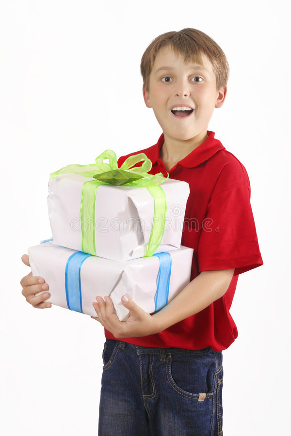Boy carrying gifts royalty free stock photos