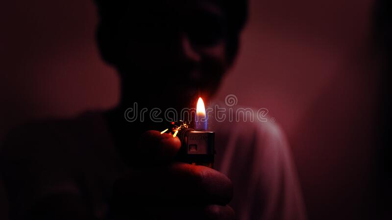 Boy carrying lighted candle
