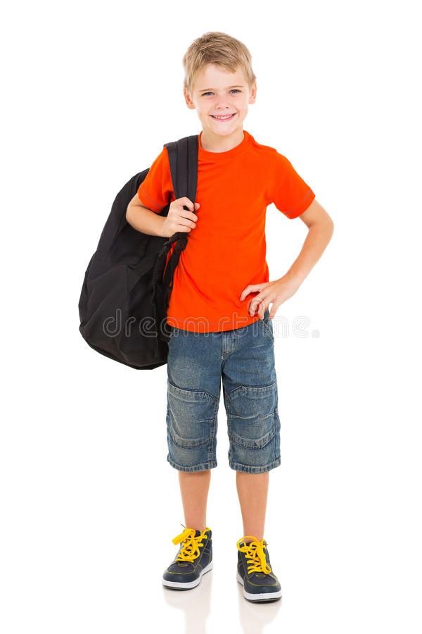 Boy carrying schoolbag. Cheerful young boy carrying schoolbag royalty free stock photography