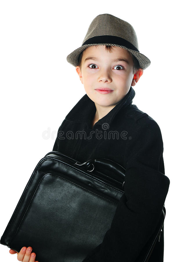 Boy with a case. Young boy wearing a hat with case on white background royalty free stock photo