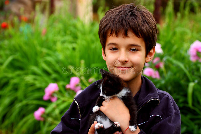 Download A boy with cat stock image. Image of background, love - 21605661