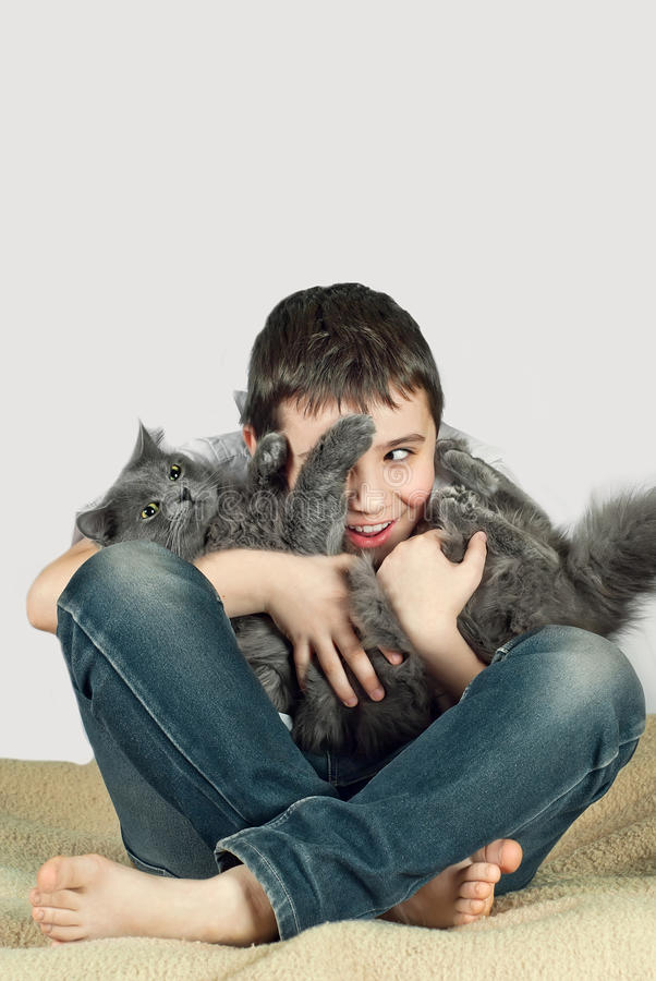 Boy with a cat on a white background9 stock photography