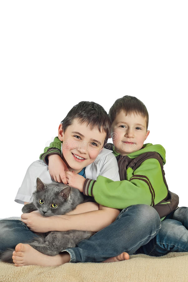 Boy with a cat on a white background6 stock image