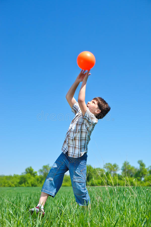 Boy catching a ball royalty free stock photos