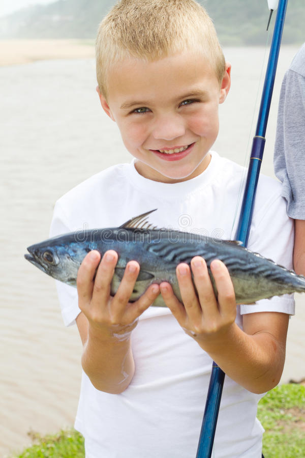 Boy caught fish royalty free stock photos