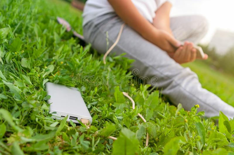 Boy charging smartphone from the power bank. stock image