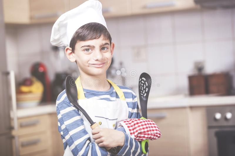 Boy chef in the kitchen royalty free stock images