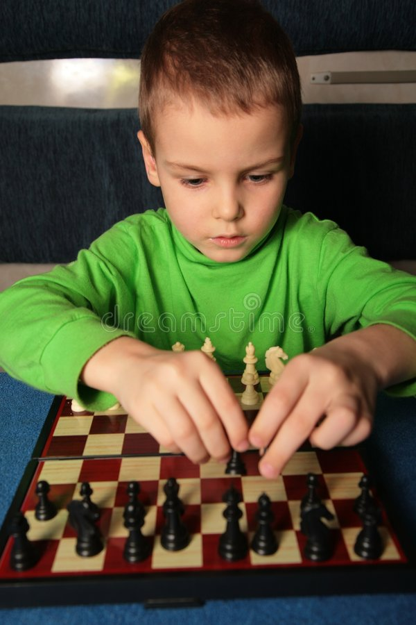 Boy and chess royalty free stock photos