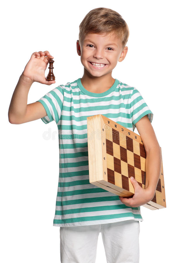 Boy with chessboard. Happy boy with chessboard isolated on white background royalty free stock images