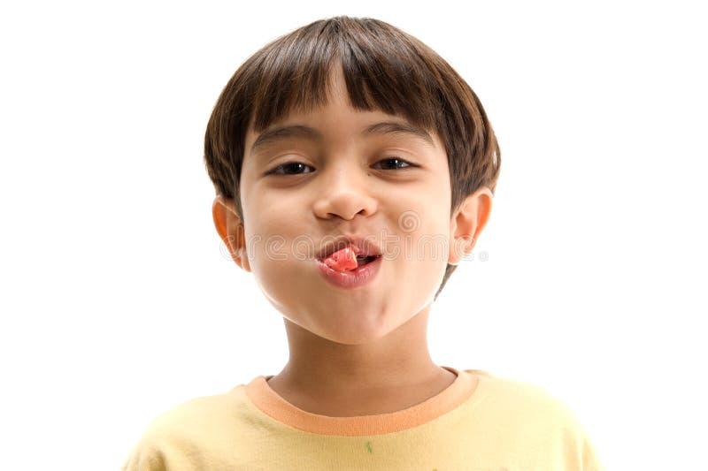 Boy chewing gum stock photos
