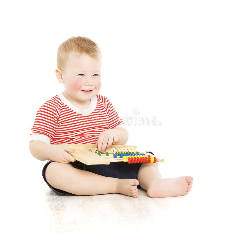 Boy child happy with abacus, smart little kid study lesson, educ royalty free stock photography