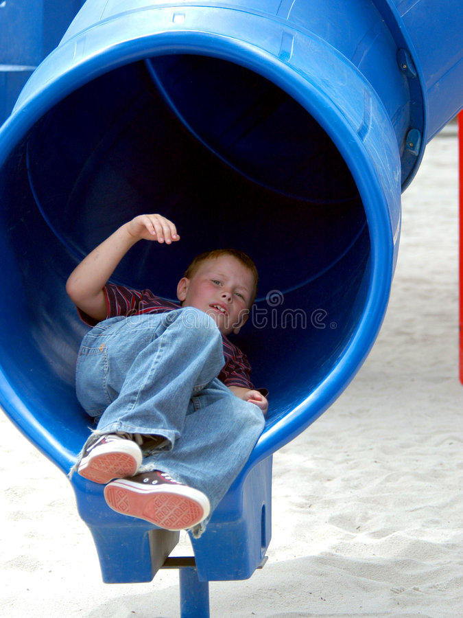 Free Boy Child In Tube Slide Royalty Free Stock Photo - 151845