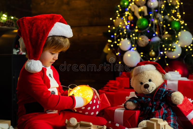 Boy child play near christmas tree. Merry and bright christmas. Childhood activity and game. Lovely baby enjoy christmas stock photography