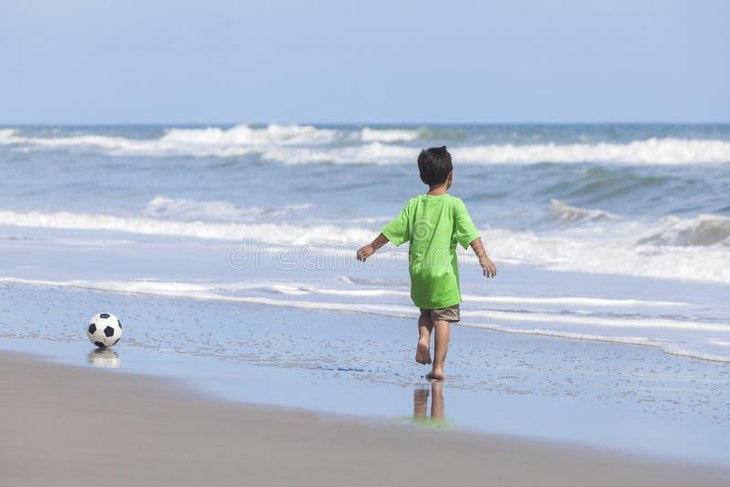 Boy Child Running Beach Playing Football Soccer royalty free stock photo