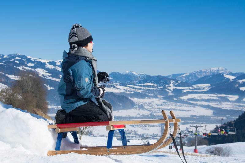 Boy child in winter on sled royalty free stock images