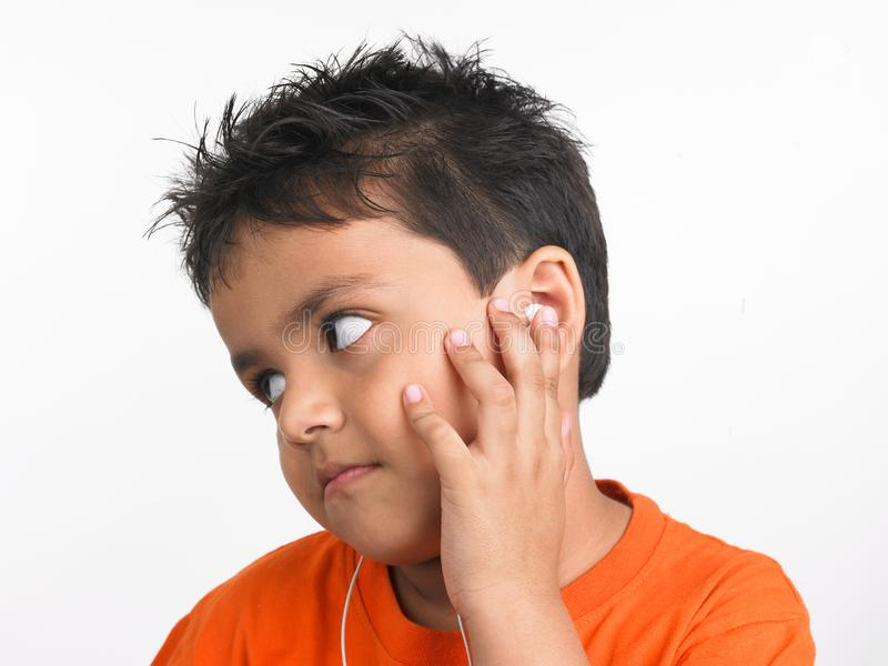 Download Boy Chilling Out Listening To Music Stock Photo - Image of sleeve, india: 6330212