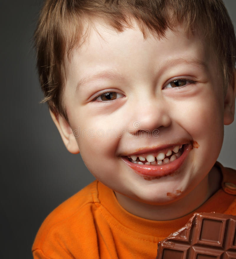 boy with chocolate bar stock photos
