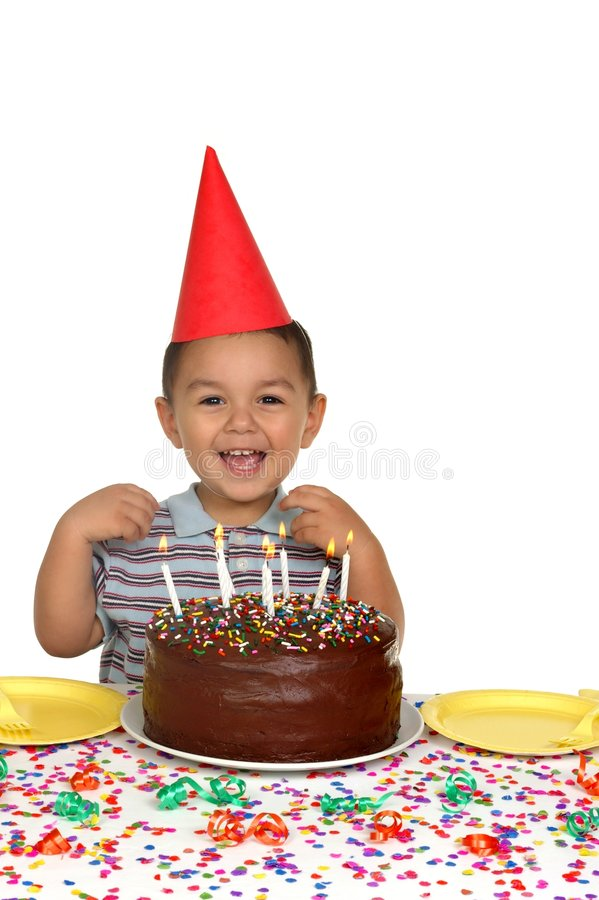 Boy and Chocolate Birthday Cake. A young child laughs over a chocolate frosted birthday cake stock photos