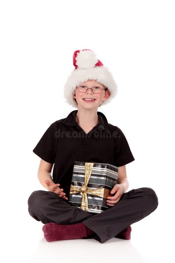 Boy Christmas present stock photos