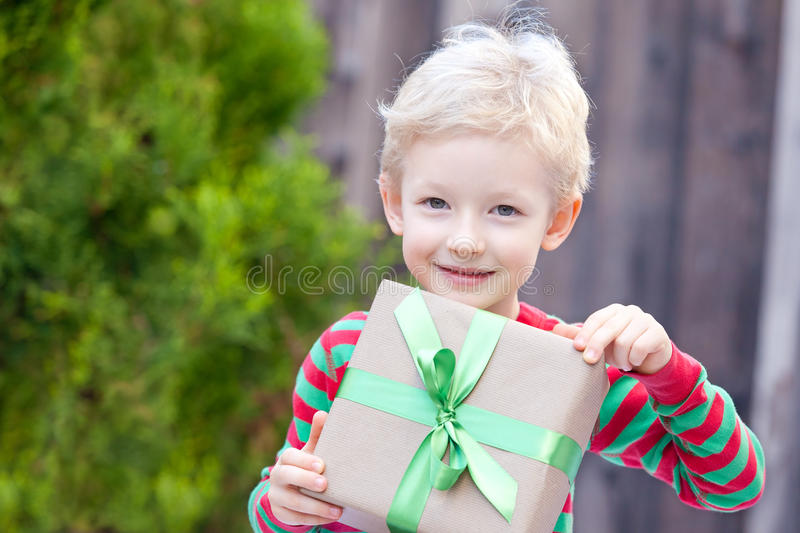 Download Boy at christmas time stock photo. Image of cute, ribbon - 34564680