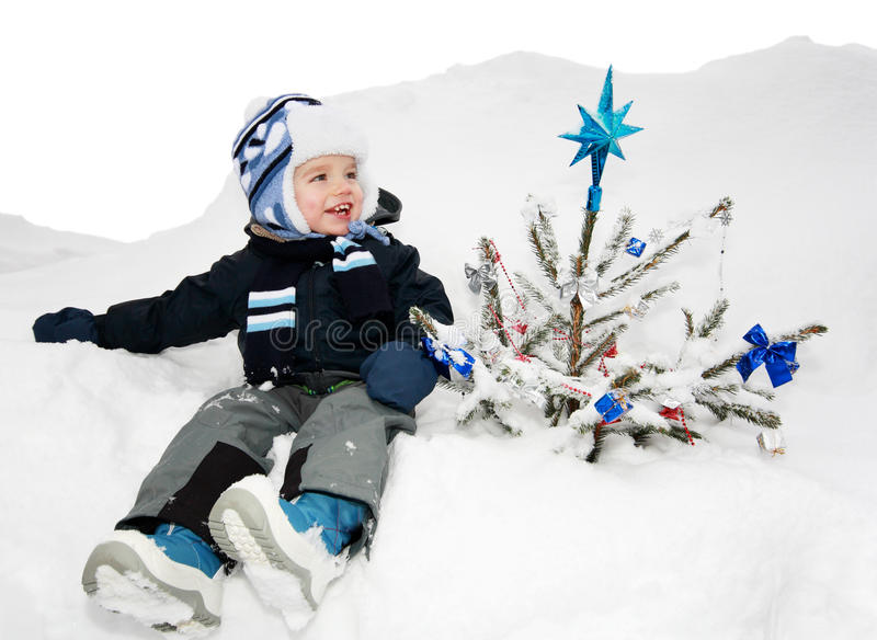 Boy and the christmas tree stock photo