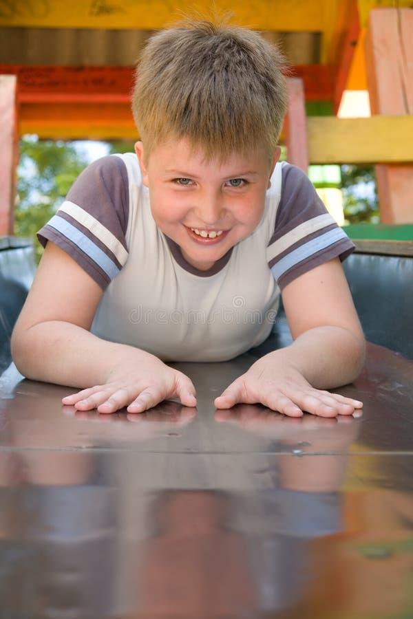 Boy on a chute royalty free stock image