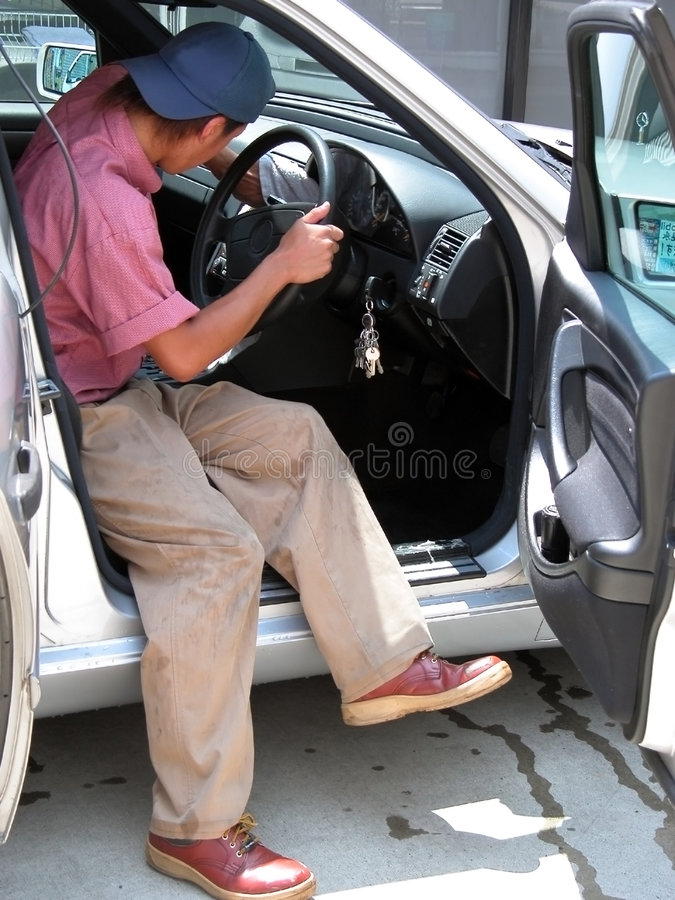 Boy cleaning the car royalty free stock photo