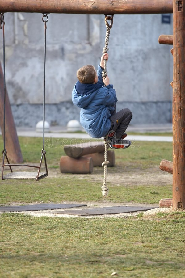 Boy climbing stock images