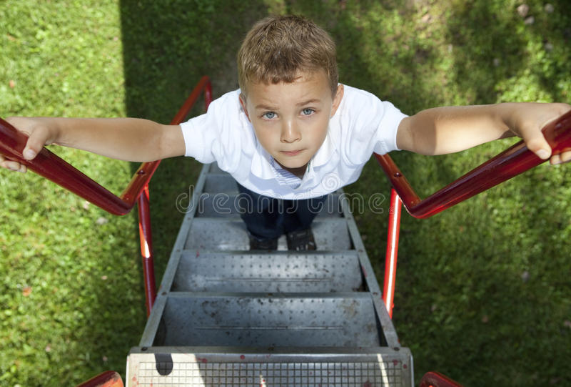 Boy climbing stock photography